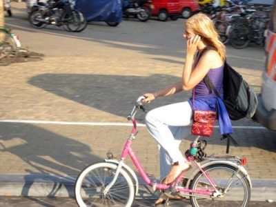 Female Cyclist Using Cell Phone