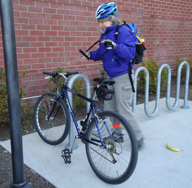 Cyclist Reassembling Bicycle Lock