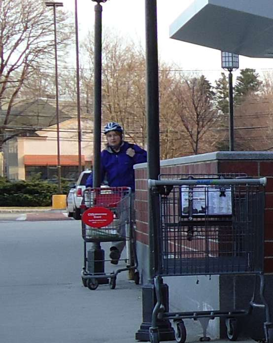 Cyclist Exiting Store