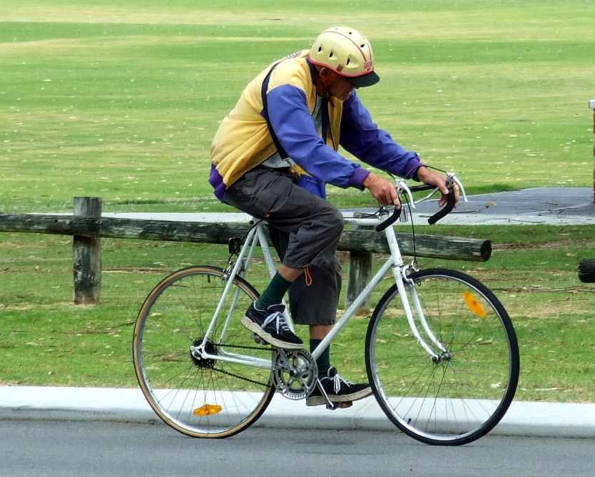 Elder Riding A Bicycle
