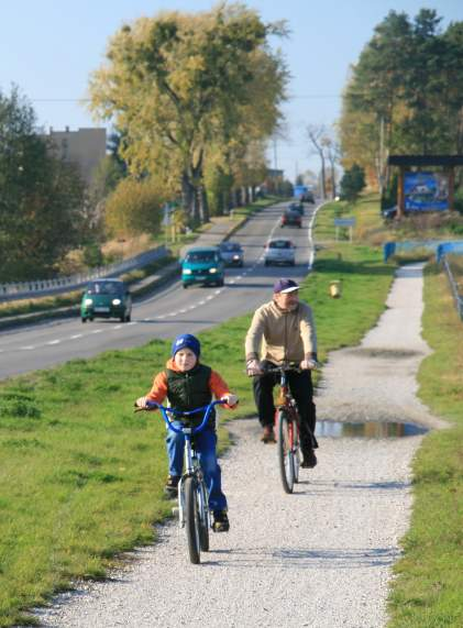 Man And Boy Riding Bikes