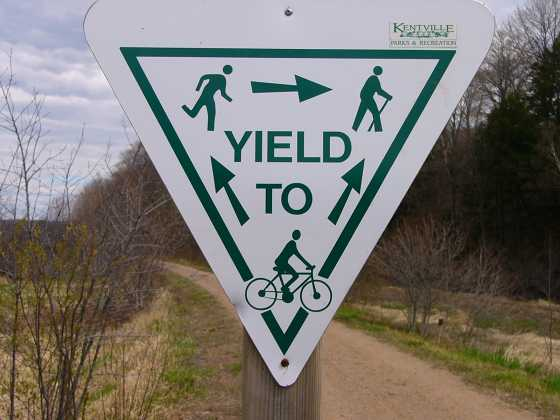 Yield To Bikes, Skiers, Runners Sign