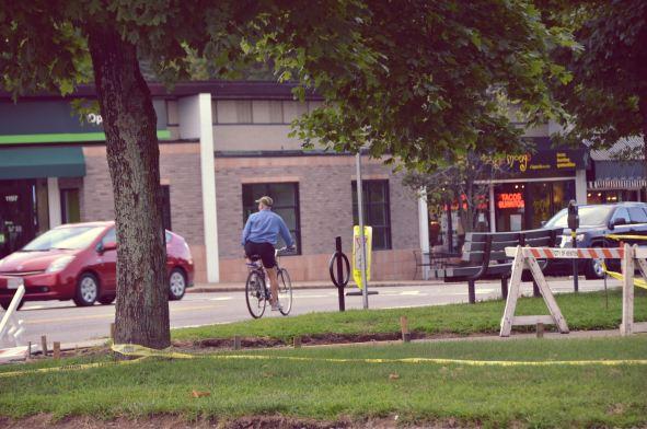 Man Riding A Bike In Newton Centre